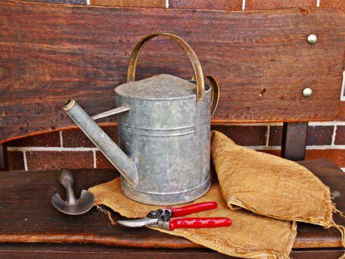 watering can secateurs trowel