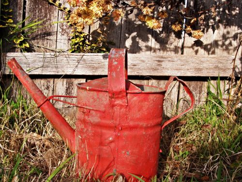 watering can red old