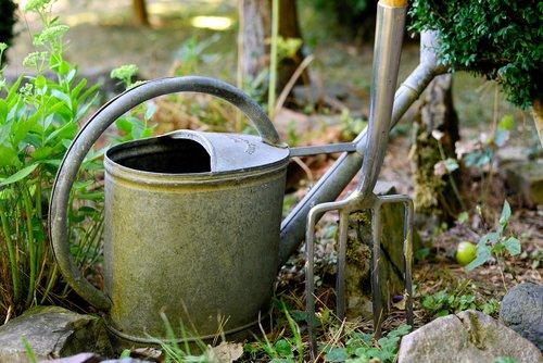 watering can  digging fork  gardening