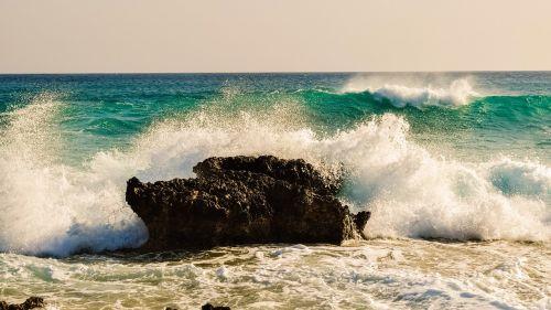 wave smashing rock