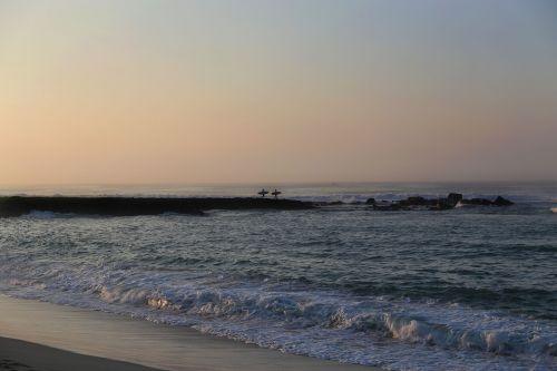 wave-breaker surfers carrying