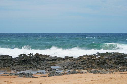 Wave Rolling Over Rocks