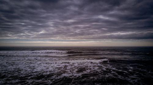 waves clouds ocean