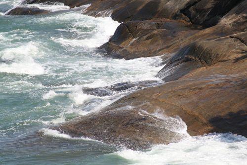 waves stones beaches