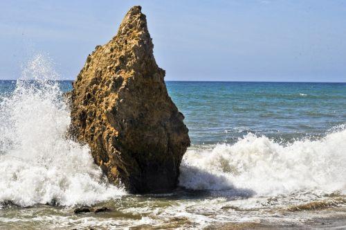 Waves Crashing Around Rock