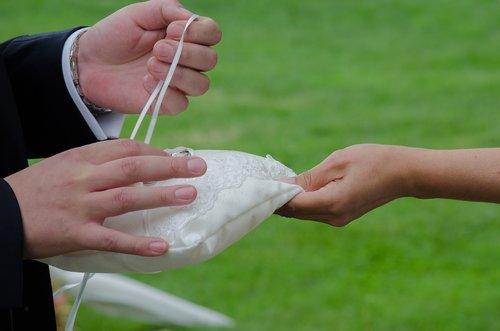 wedding  ring pillow  hands