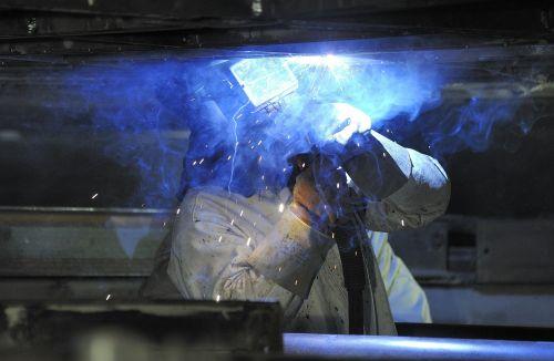 weld hot soldering workers
