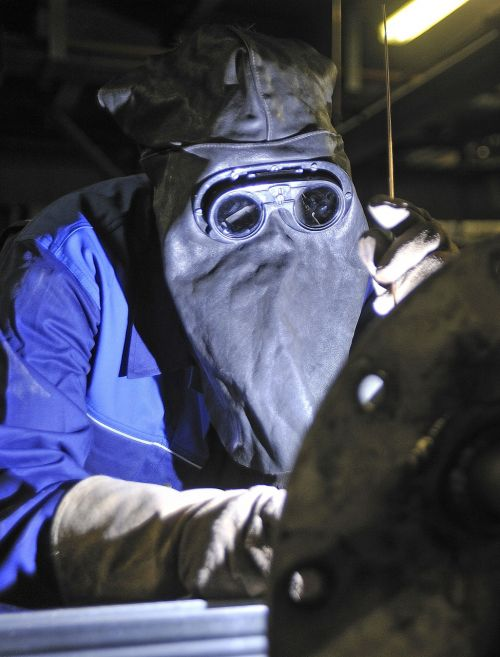 welder hot soldering workers