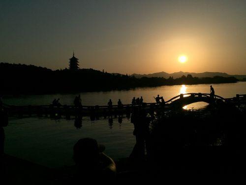 west lake sunset bridges