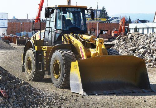 wheel loader building rubble demolition