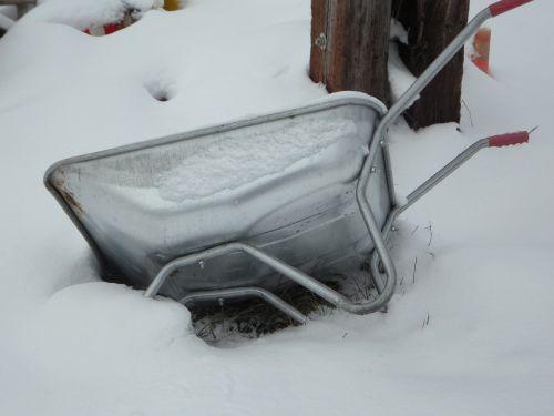 wheelbarrow snowdrift snow