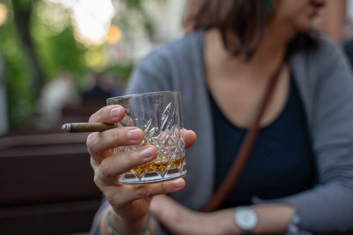 whiskey glass  cigar  hand