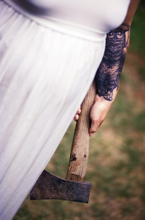white dress axe tattoo