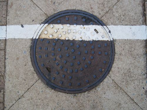 White Line Painted Over Manhole
