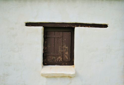 White Wall And Window Shutter