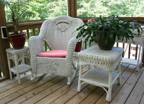 wicker rocking chair porch white table