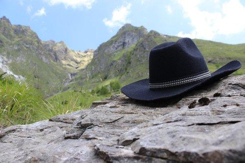 wild west  hat  mountains