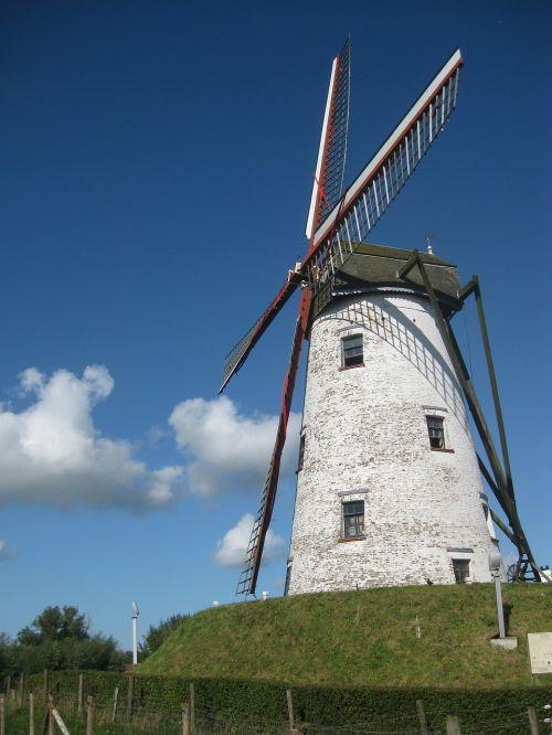 wind mill,blue sky,mill blades,historic building