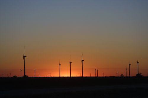 wind turbines alternate energy sunset