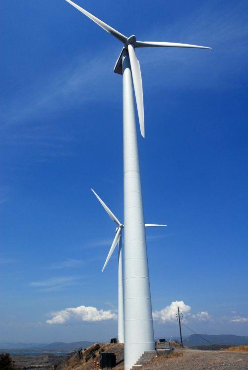 wind turbines sky clouds