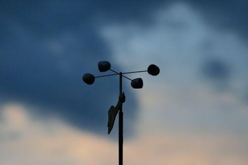 Wind Vane Against The Sky