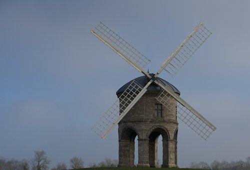 windmill  windmill on a hill  blue sky