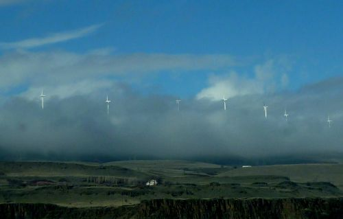 windmills low clouds sky