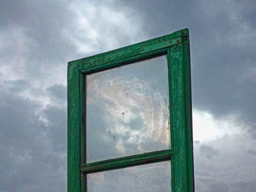 window gray sky threatening
