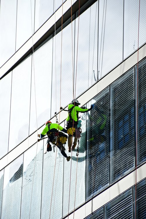window cleaner  high rise building cleaner  building glass maintenance