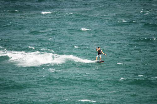 Windsurfer Holding On To Kite