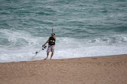 windsurfer on beach beach sand