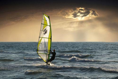 windsurfing sea clouds