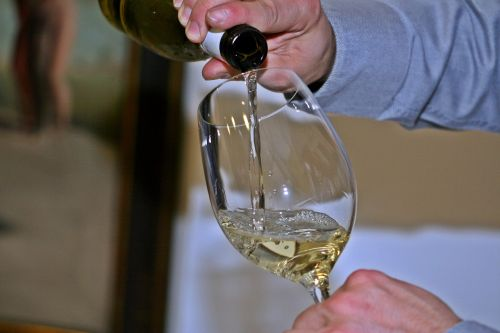 wine pouring sommelier