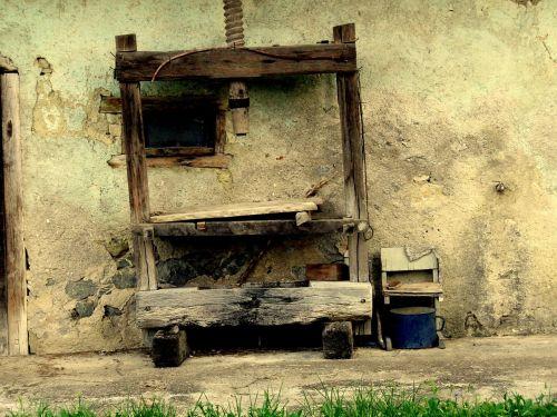 wine press metal bucket old wood