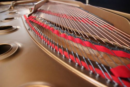 wing strings concert grand piano