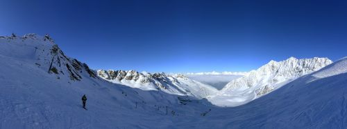 winter,mountain,panorama,travel,cold,ski,alps,snow,blue,sky,sun,scenery,holiday,vacation,adventure,hill,top,view,perspective,wide,outdoors,high,peak,europe,landscape,nature,ice,beautiful,breathtaking,horizon