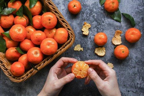 winter fruit  peel an orange  small orange