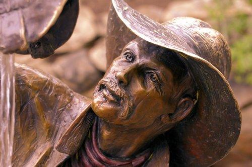 wishful thinkin cowboy  sculpture  bronze