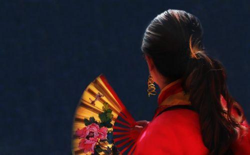 woman red fan