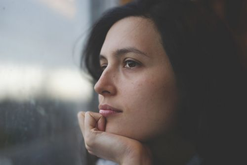 woman thoughtful pensive