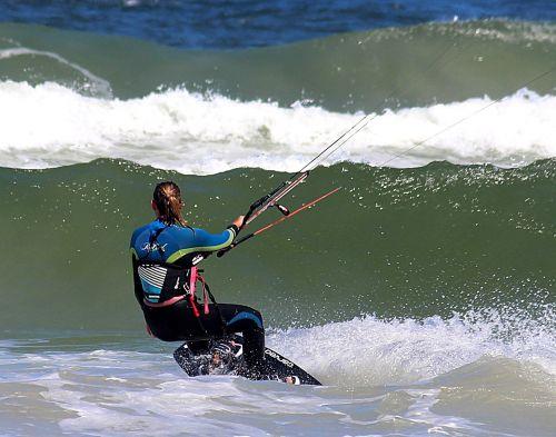 woman kiting wave