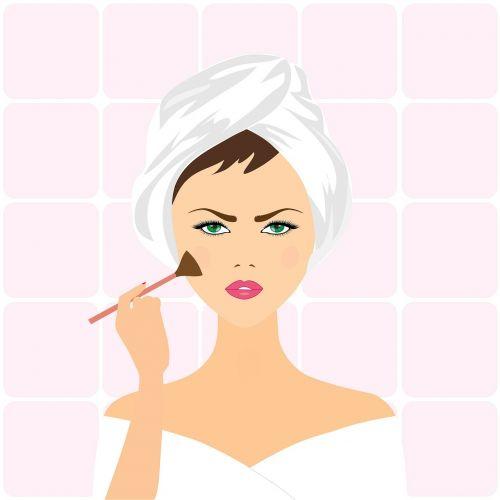 woman applying make-up applying