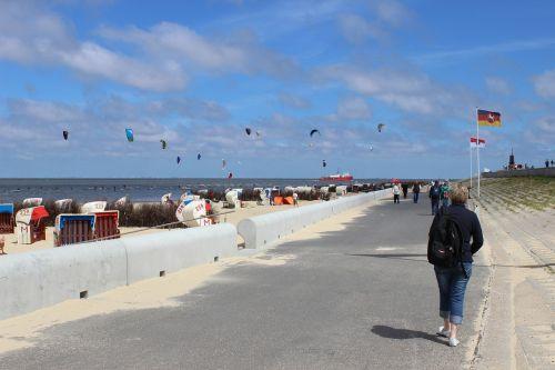 woman beach sky