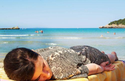woman sleeping sun bed