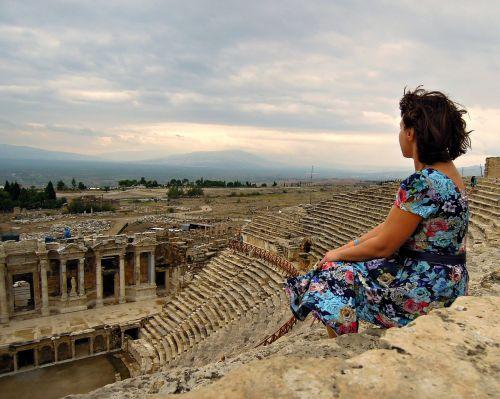 woman sitting amphitheater