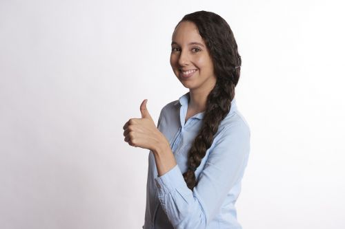 woman thumbs up smiling