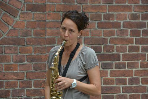 woman saxophone summer