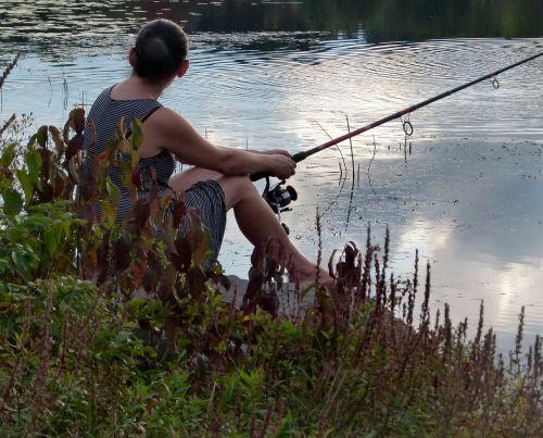 woman fishing lake