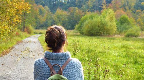 woman away nature