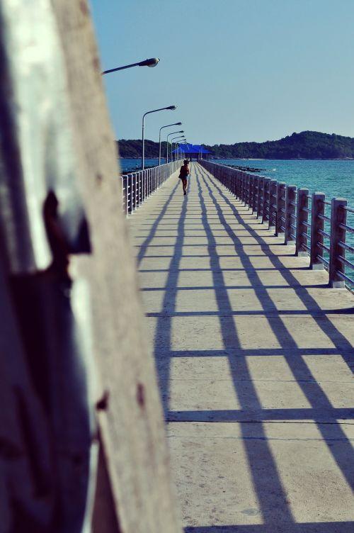 woman ocean bridge